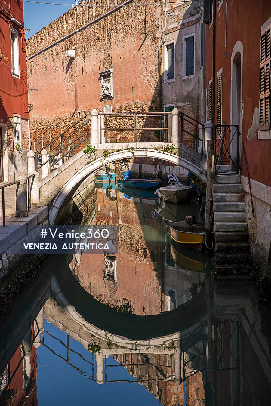 One of the 391 bridges in Venice. On the background of this private bridge, the tall walls of the Arsenale.