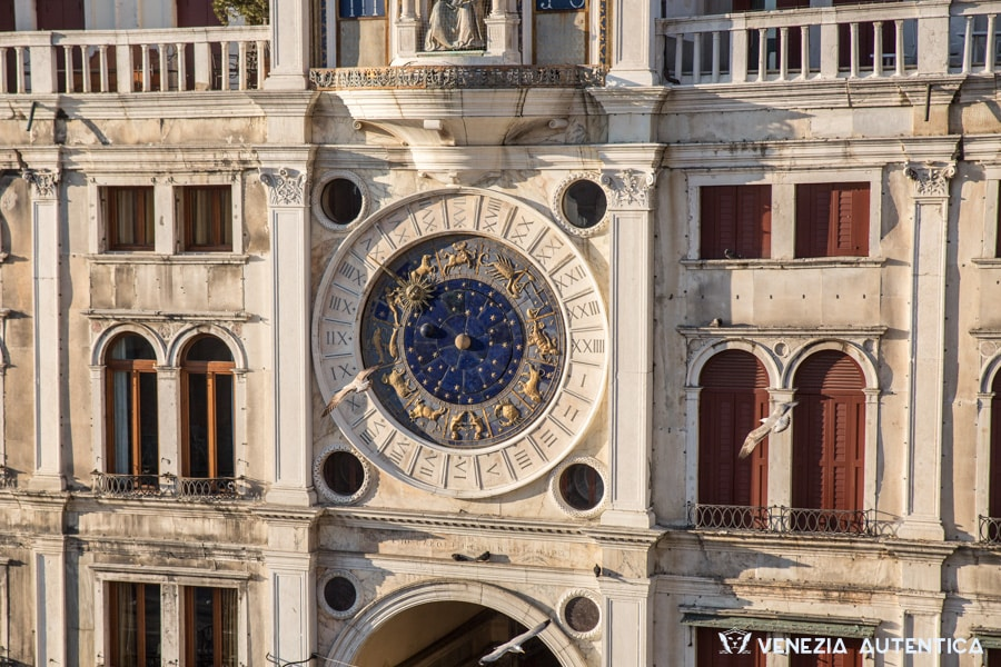 Particular of the Clock Tower in Saint Mark's Square in Venice. Golden Zodiac Signs on a blue background