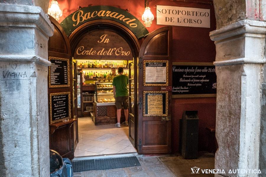 "Entrance of the ""Bacarando in Corte dell'Orso"" bacaro bar in Venice, Italy. Close to the rialto bridge, this wine bar offers good venetian cichetti and a friendly service"