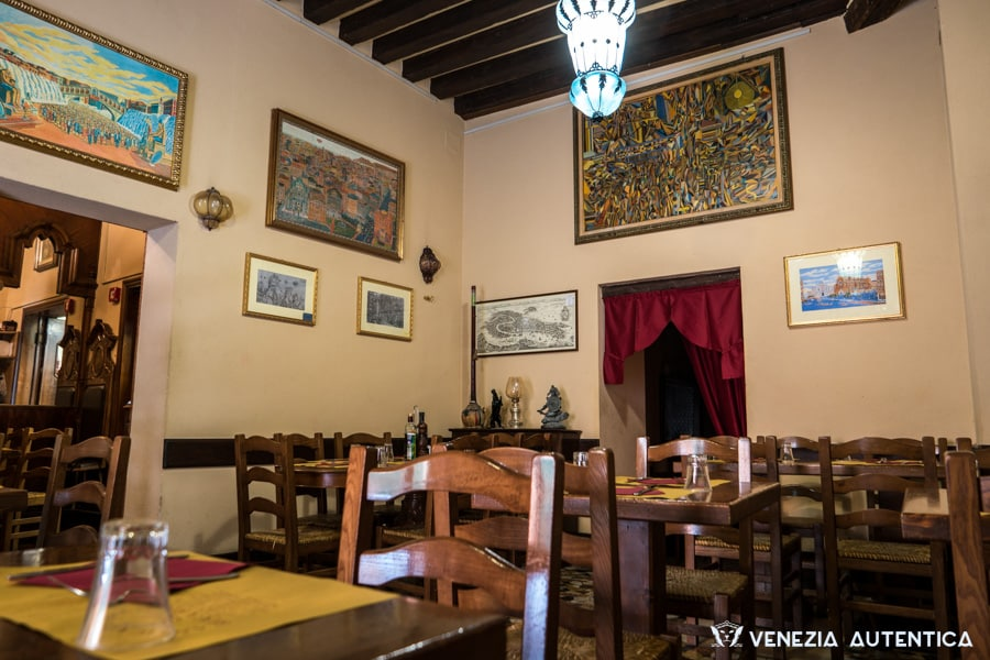 Inside the Antica Osteria Ruga Rialto, in Venice. Nice rooms with venetian paintings and decorations.