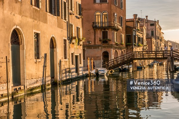 Golden light reflecting on a Venetian canal at sunset