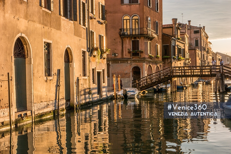 Golden reflection on the canal of Venice in the district of Cannaregio