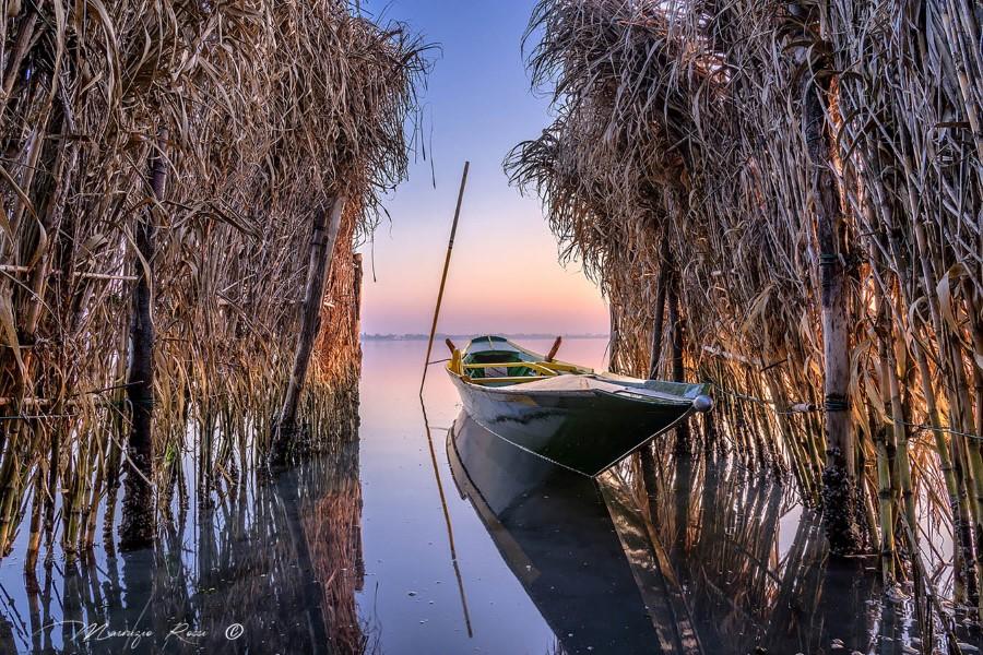 Sandolo in the Lagoon of Venice close to the island of Burano, by Maurizio Rossi