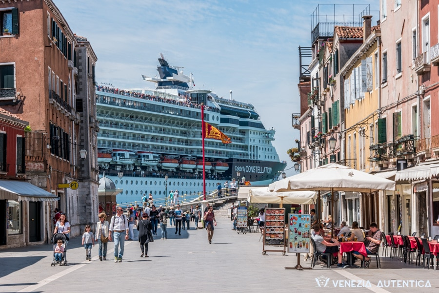 Big Cruise Ship passing in front of Via Garibaldi in Venice, Italy. Cruise ships pass right in the heart of Venice.