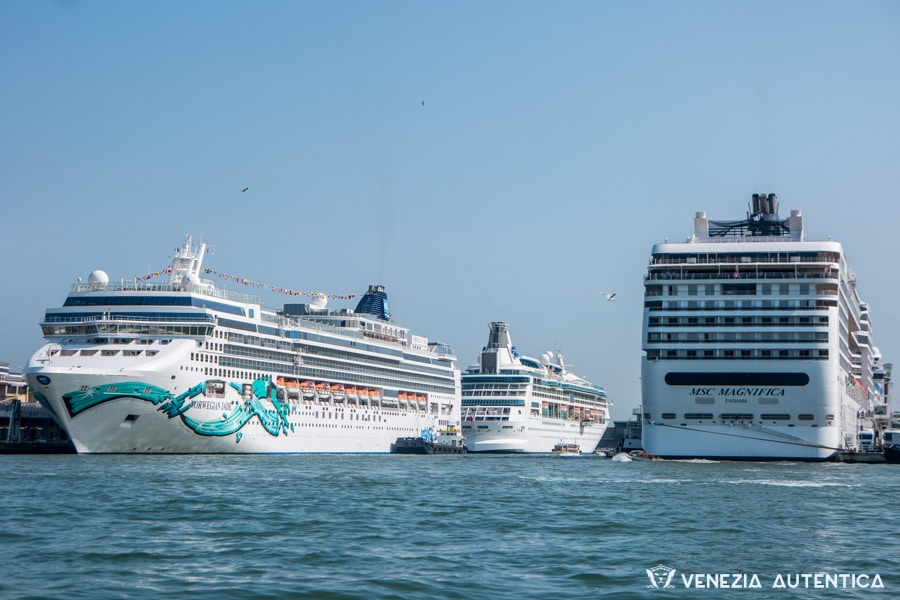 Three big cruise ships docked at the port of Venice, Italy. The ships' engines are kept on all the time to provide electricity to the amenities on board, contributing enourmously to the pollution of the air in town.