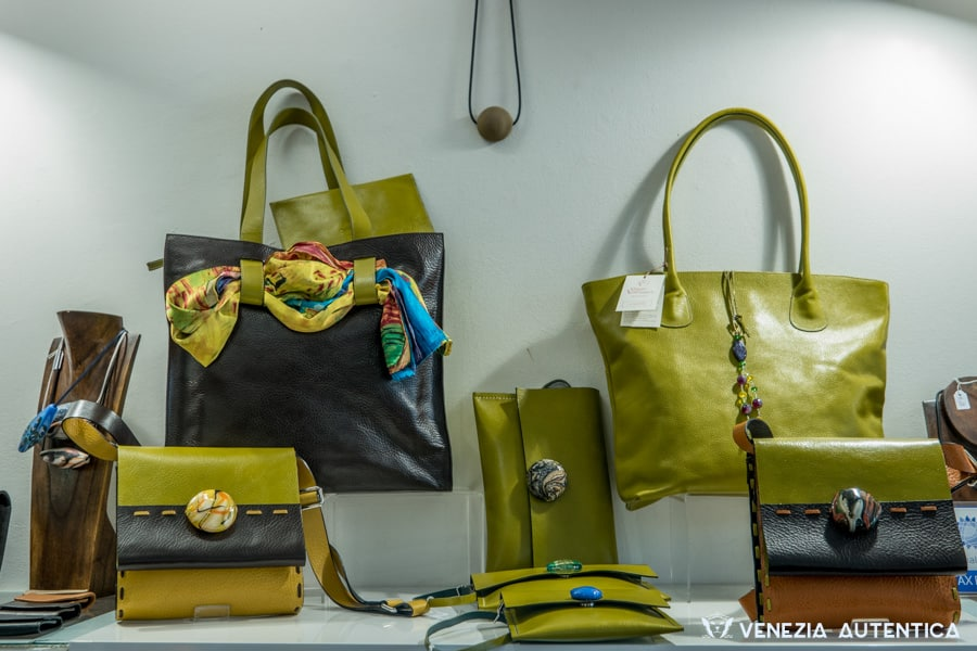 Raggio Veneziano in Venice, Italy, makes use of high quality leather and high quality artisanal products, such as elegant Murano glass buttons, to create beautiful, elegant and unique leather bags and accessories.
