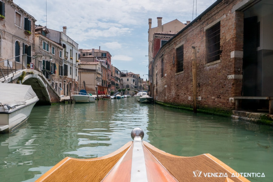 First person view from a Venetian rowing boat on a canal in Venice