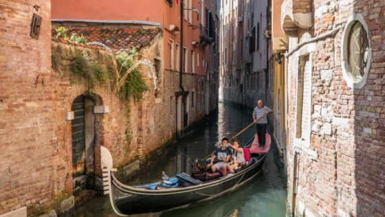 Couple doing a gondola ride in Venice, Italy