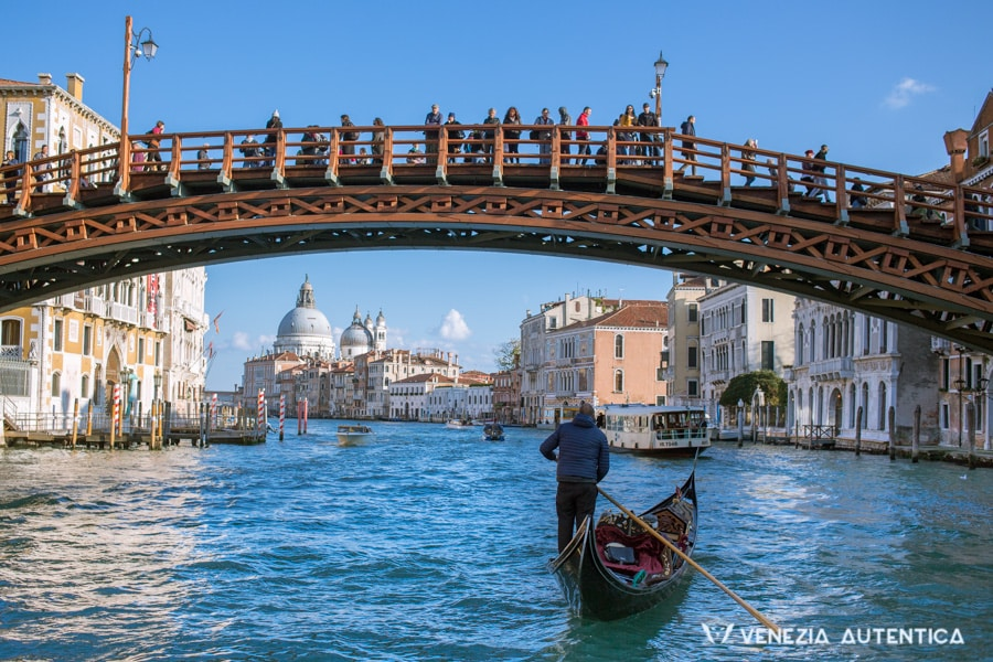 Beautiful day in Venice. Gondola on the Grand Canal, under the Accademia bridge