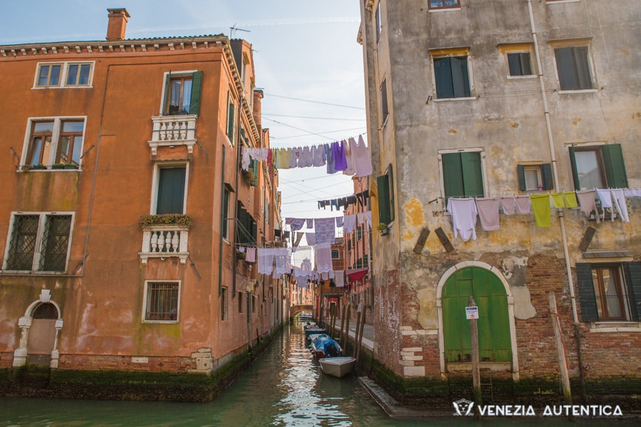 Venice Weather in Spring, with clothes drying on lines outside the houses and over canals