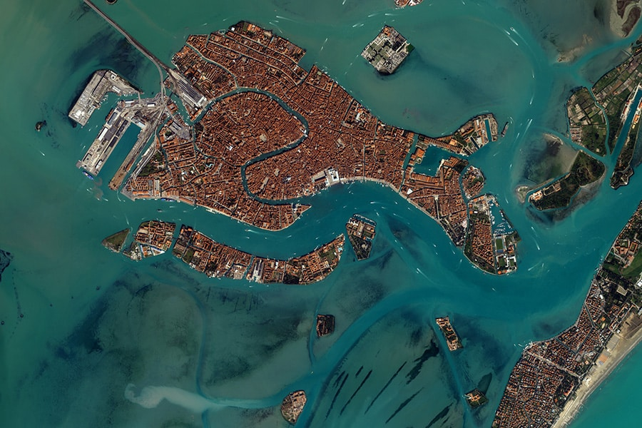 Venice as seen from the space. Venice looks like a fish made of bricks, floating on water