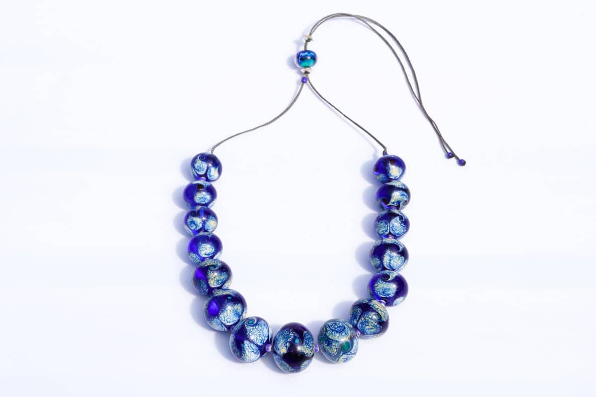 """How Deep, How Blue"" Necklace Shop by Venezia Autentica - Shop by Venezia Autentica - Stunning deep-blue Murano Glass necklace, designed and handmade in Venice, Italy. Every bead, handmade through lampworking, is unique, beautiful, and durable"